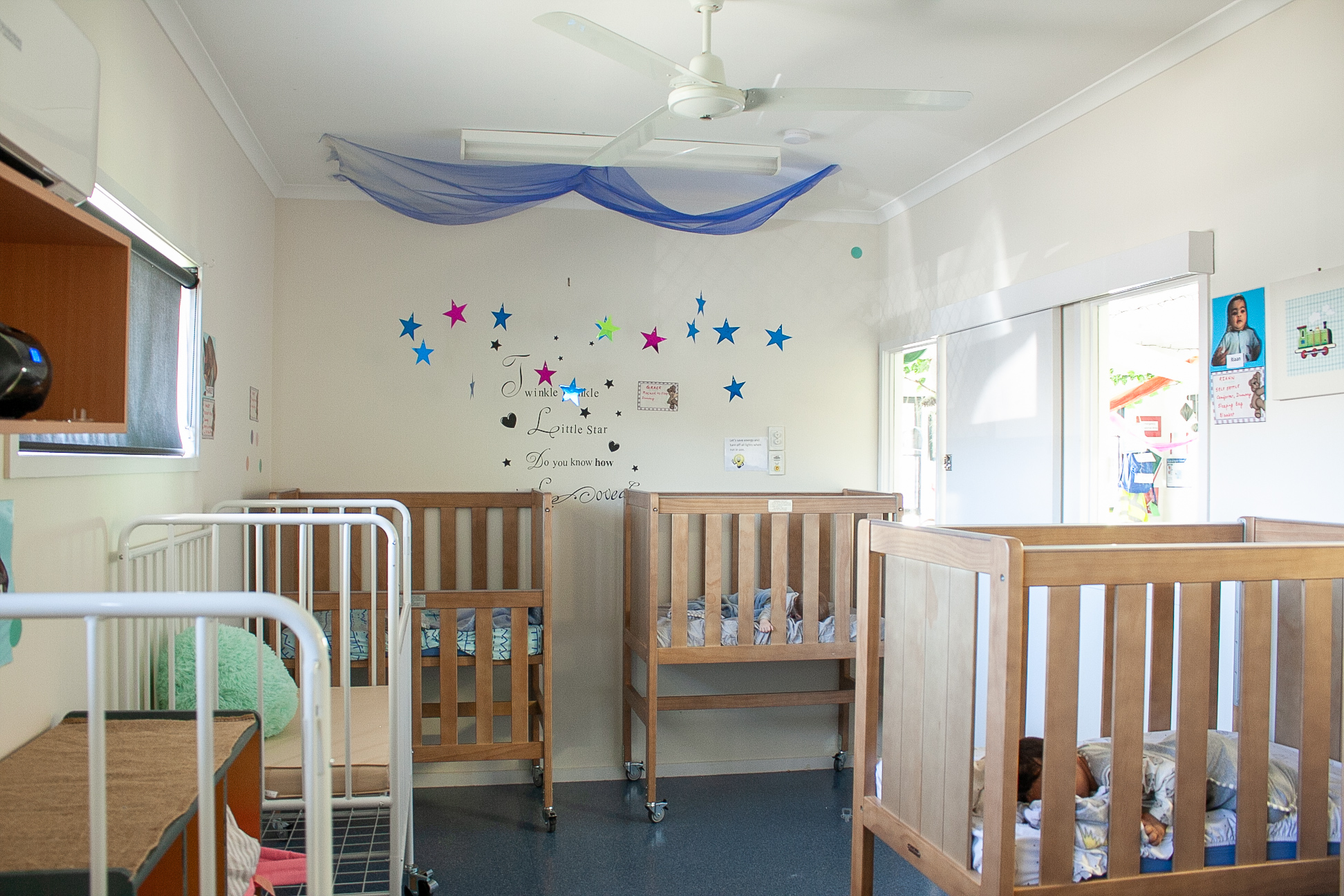 A nursery room with 6 baby cots in view