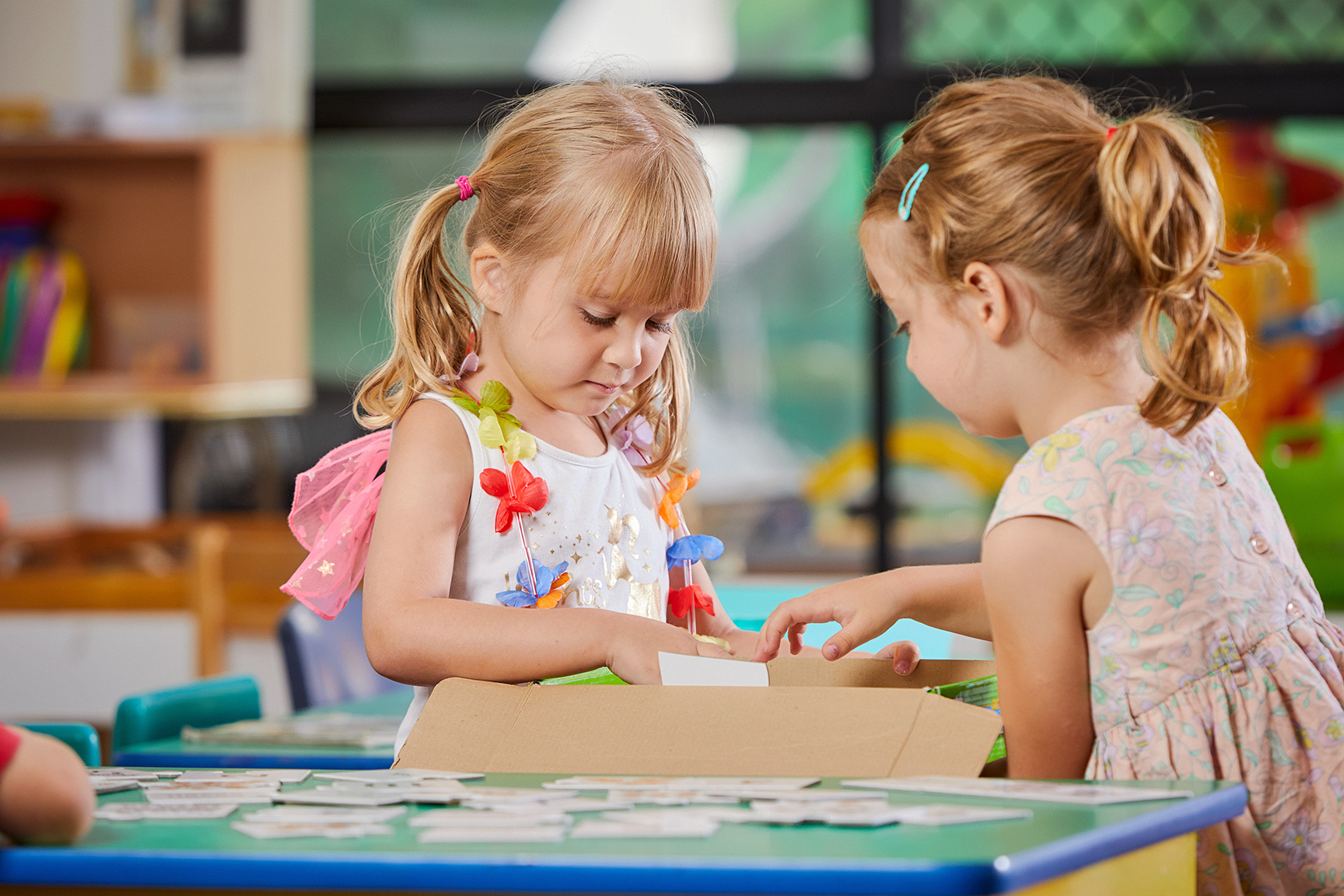 2 children in classroom learning about puzzles